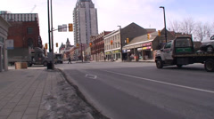 Stock Video Footage of 18 wheelers driving through a down town main street. #12-26