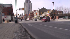 Stock Video Footage of 18 wheelers driving through a down town main street. #15-26