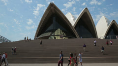 Visitors climb steps to sydney opera house on a sunny day, australia Stock Footage