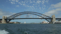Tracking shot from ferry of harbour bridge and opera house, sydney, australia Stock Footage