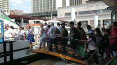Passengers board ferry at circular quay, sydney, australia Stock Footage