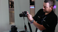 Demonstratng the New Panasonic GH4 4K DSLR to media Stock Footage