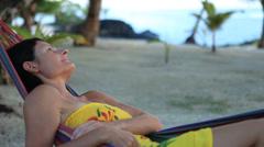 Woman relaxing in hammock Stock Footage