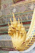 Five naga head in the temple of the emerald buddha Stock Photos