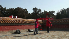 The old man and woman play diabolo together during Chinese Spring Festival Stock Footage