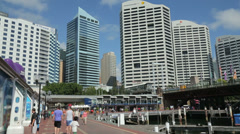 Stock Video Footage of tourists, promenade at cockle bay wharf, darling harbour, sydney, australia