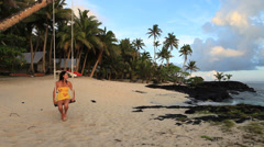 Woman on tropical island beach Stock Footage
