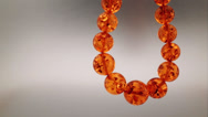 Stock Video Footage of amber jewelry necklace with copy space