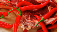 Stock Video Footage of beef spare ribs red with chili pepper