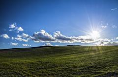 HDR photography at the shinig sun over the Navarra's meadows - stock photo