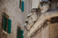 Stock Photo of stone heads at cathedral of st. james in sibenik, croatia