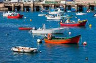 Stock Photo of old pier with boats at sagres, portugal
