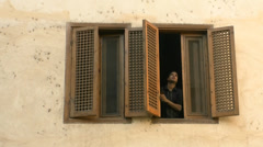 Window and person in coptic district cairo Stock Footage