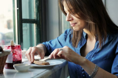 Young woman during tasty breakfast, preparing sandwich in cafe NTSC Stock Footage