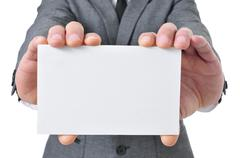 man in suit holding a blank signboard - stock photo