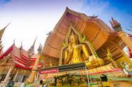 Stock Photo of the golden buddha image, wat tum sue, thailand