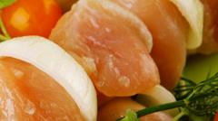 Raw chicken kebabs on dark plate Stock Footage