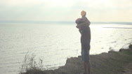 Stock Video Footage of Father holding son on shoulders standing on a cliff.