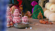 Stock Video Footage of Indian women selling ceramic pots on the street