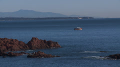 Massif de L'Esterel Fishing Boat by Porphry Rocks Stock Footage