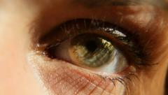 A girl eye wearing cosmetic contact lens (Gold). Eye expressions. - stock footage