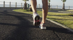 Mixed race woman runner running on road Stock Footage