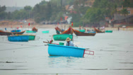 Stock Video Footage of Colored round fishing boats floating in the harbour