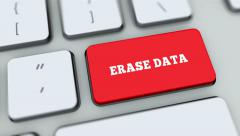 Erase Data button on computer keyboard. Key is pressed, click for HD - stock footage