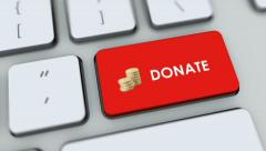 Donate button on computer keyboard. Key is pressed, click for HD Stock Footage