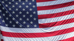 933 - full frame American Flag waving in wind, rolls out of frame Stock Footage