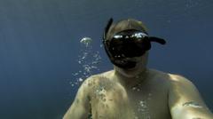 2K : mid, snorkeler surfacing Stock Footage