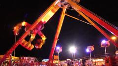 Carnival Fair Ground Ride Night - Big Swing Stock Footage