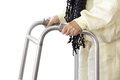 Senior woman using a walker Stock Photos