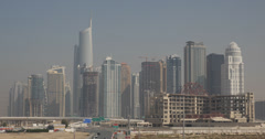 Stock Video Footage of Ultra HD 4K Crowded Busy City Dubai Marina Skyline Almas Towers Skyscrapers