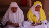 Stock Video Footage of Traditionally dressed Indonesian females pray and chant muslim songs