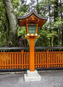 Ornamental orange wooden lantern at a japanese shinto shrine Stock Photos