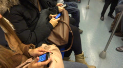 Passengers using phone in metro subway Stock Footage