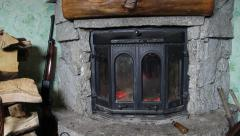 Firewood, fireplace and a shotgun - forester's house. - stock footage