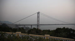 Tsing Ma Bridge in Hong Kong at sunset Stock Footage