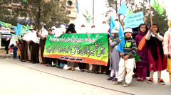 Women and Children Demonstrating at an Islamist Rally in Islamabad Stock Footage