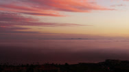 Stock Video Footage of 4K Sunset Afterglow and Coastal Fog Time Lapse -Tilt Up-