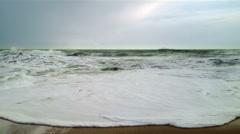 Big waves breaking onto sandy beach in Cornwall Stock Footage