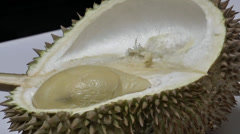 Picking a durian fruit from the pod.(OPEN A DURIAN--8) Stock Footage