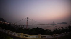 Tsing Ma Bridge in Hong Kong at sunset Stock Footage