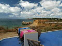 Terrace overlooking the beautiful beach and cliff Stock Photos