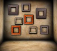 Wooden frames on grungy wall Stock Illustration