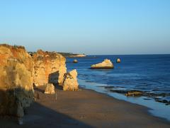 Praia da rocha in the glow of the sunset Stock Photos