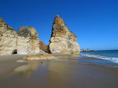 A section of the idyllic praia de rocha beach on the southern coast of the po Stock Photos