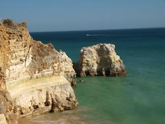 Colorful rock cliffs of the algarve in portugal Stock Photos