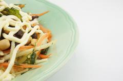 salad with tomato raisins carrot and mayonnaise - stock photo